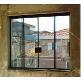 Fechamento de área de serviço com vidro no Jardim São Luiz