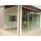 Porta de vidro articulada no Campo Grande